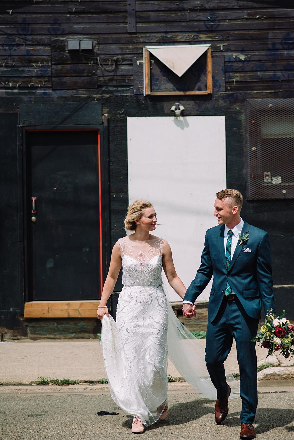 edmonton-bride-groom-walking-holding-hands